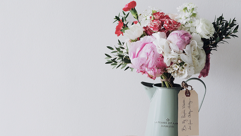 a vase with colorful flowers for good mood