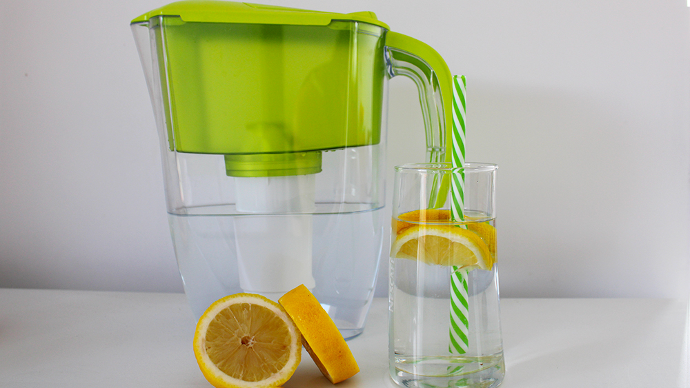 A glass of lemon water and an eco-friendly straw