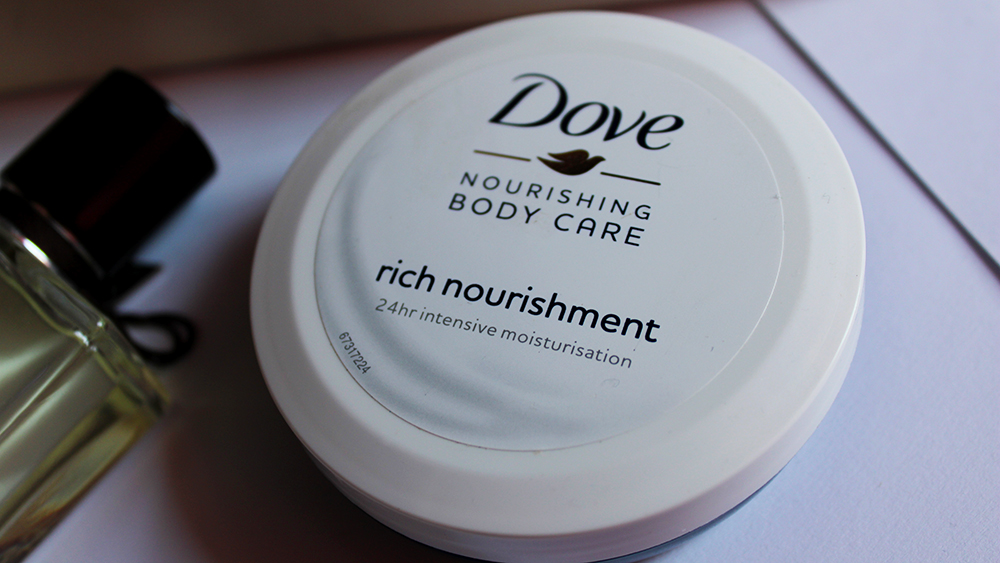 Dove Nourishing moisturizing face cream and Van Cleef and Arpels women's perfume
